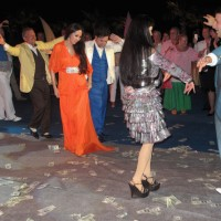 ...Here's A Photo Of The Russo-Azeri Oligarch Dancing On 100 Dollar Bills With His Family...