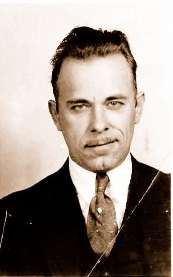 Plus, that John Dillinger-inspired haircut really helps: almost