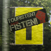 "Tourists, Raus! Berlin Rebels Ignite ""A Bonfire Of Automobiles"""