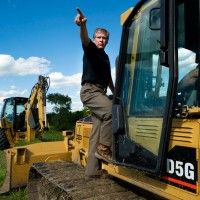 "Caterpillar CEO's Business Strategy: ""Bluster While You Plunder"""